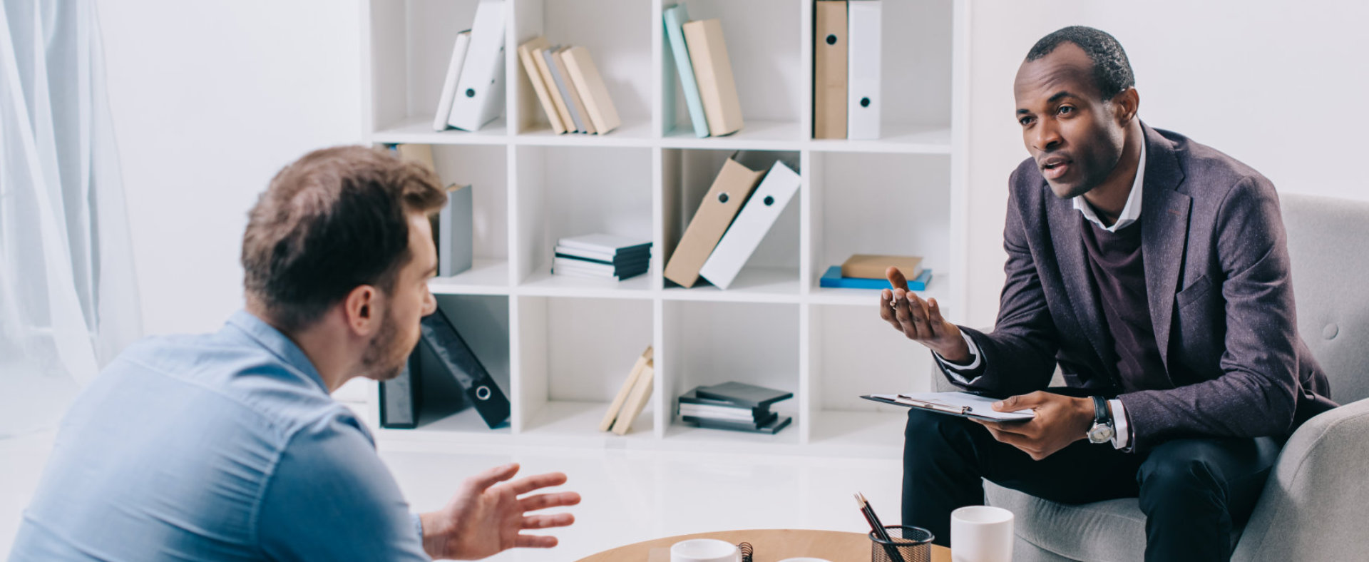 man consultant doing counseling to his client at office