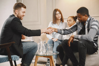psychologist working with a family